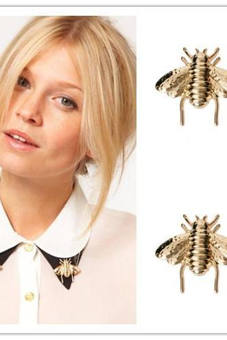 With a big metal bee insect brooch